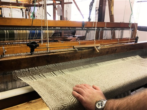 Studio Donegal Tweed being woven on traditional loom