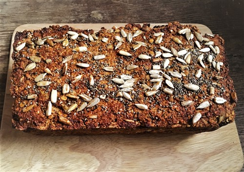 Porridge bread out of the oven with toasted seeds on top