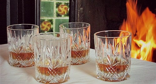 Galway Crystal Tumblers filled with Irish Whiskey in front of open fire