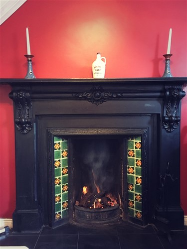Antique Fireplace with turf fire at Gilmartin's Craft Shop, Belleek, Fermanagh, Ireland