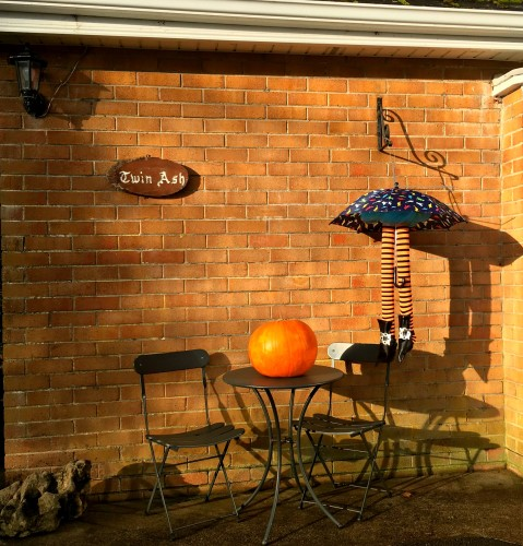Large Pumpkin and Witch Legs Decoration outside house for Halloween