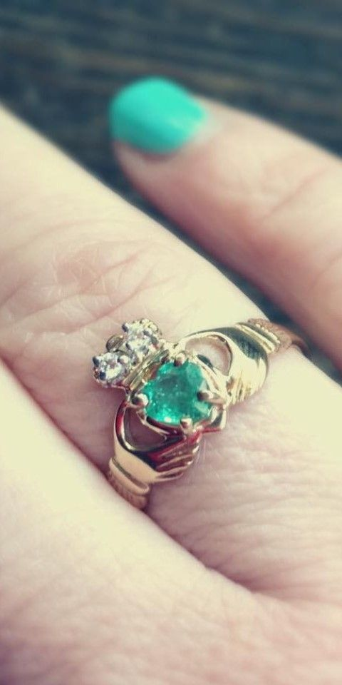 Irish Emerald Gold Claddagh Ring on Hand